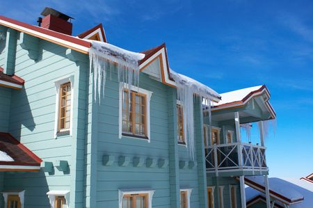 icicles: Natty house with icicles Stock Photo