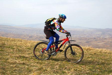 Biker downhill on autumn hill Stock Photo - 697688