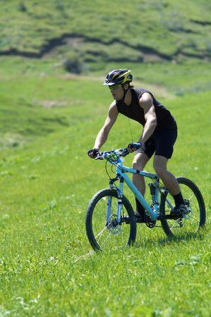 Biker on green hill race