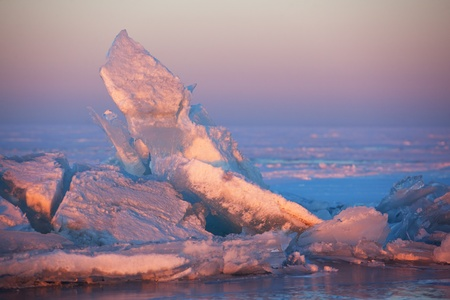 Winter sunset and  ice hummocks on the Lake Balkhash, Kazakhstan Stock Photo - 10823391
