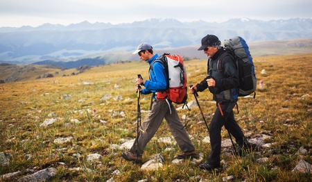 backpackers: Two backpackers in wilderness mountains