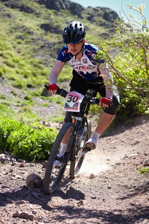 ALMATY, KAZAKHSTAN - MAY 2: M.Budko (N30) in action at Adventure mountain bike cross-country marathon in mountains