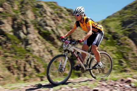 ALMATY, KAZAKHSTAN - MAY 2: G.Balagurova (N28) in action at Adventure mountain bike cross-country marathon in mountains