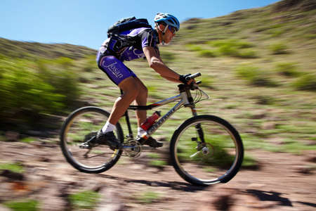 ALMATY, KAZAKHSTAN - MAY 2: I.Popov (N5) and other in action at Adventure mountain bike cross-country marathon in mountains