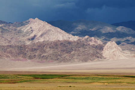 Desert mountain and storm sky in the Mongolia