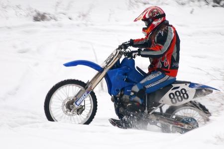 ALMATY, KAZAKHSTAN - JANUARY 29: Racer J.Gusenkov (N888) of Slovak republic participates in the Motoskijoring January 29, 2012 in Almaty, Kazkahstan.