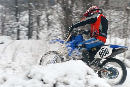 ALMATY, KAZAKHSTAN - JANUARY 29: Racer J.Gusenkov (N888) of Slovak republic participates in the Motoskijoring January 29, 2012 in Almaty, Kazkahstan.