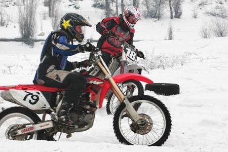 ALMATY, KAZAKHSTAN - JANUARY 29: Racer E.Kadirov (N18) at Winter motocross January 29, 2012 in Almaty, Kazkahstan.