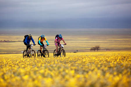 bikercross: ALMATY, KAZAKHSTAN - MAY 2: I.Popov (N22) and others in action at Adventure mountain bike cross-country marathon in mountains
