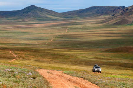 rough road: Roads in the desert steppes of Mongolia Stock Photo