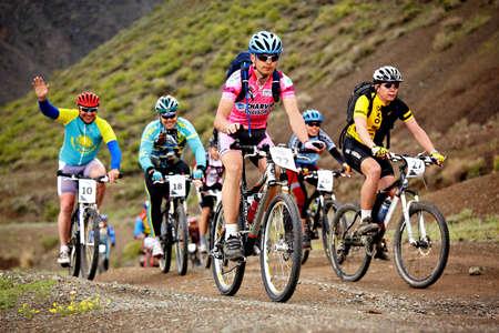 bikercross: ALMATY, KAZAKHSTAN - MAY 2: Mountain bikers in action at Adventure mountain bike cross-country marathon  Editorial