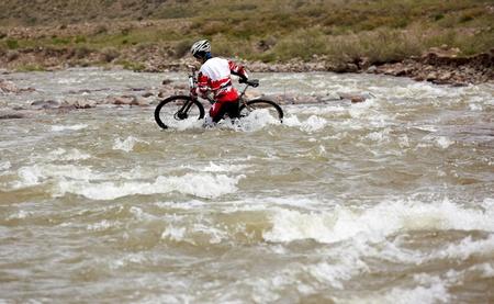 bikercross: ALMATY, KAZAKHSTAN - MAY 3: R.Fayzullin (N17) in action at Adventure mountain bike cross-country marathon in mountains