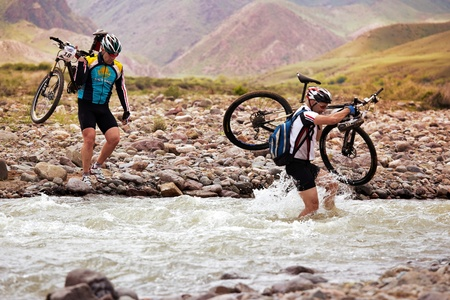ALMATY, KAZAKHSTAN - MAY 3: T.Jurkashev (right) in action at Adventure mountain bike cross-country marathon in mountains  Stock Photo - 12262017
