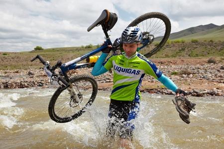 bikercross: ALMATY, KAZAKHSTAN - MAY 3: A.Kaspersky (N4) in action at Adventure mountain bike cross-country marathon in mountains  Editorial