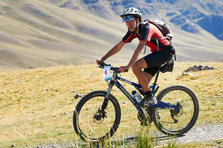 ALMATY, KAZAKHSTAN - SEPTEMBER 04: P.Krasovetsky (N4)  in action at Adventure mountain bike cross-country marathon in mountains