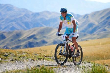bike trail: ALMATY, KAZAKHSTAN - SEPTEMBER 04: E.Kazantsev (N7)  in action at Adventure mountain bike cross-country marathon in mountains