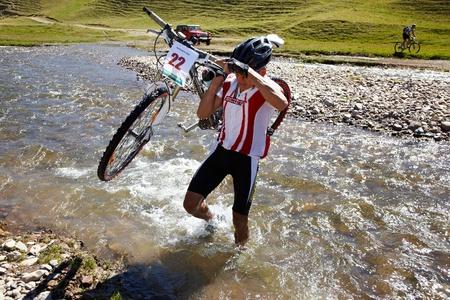 bikercross: ALMATY, KAZAKHSTAN - SEPTEMBER 05: E.Janabaev(N22) in action at Adventure mountain bike cross-country marathon