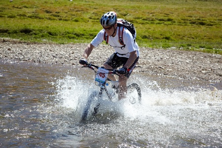 bikercross: ALMATY, KAZAKHSTAN - SEPTEMBER 05: D.Vasiliev(N45) in action at Adventure mountain bike cross-country marathon