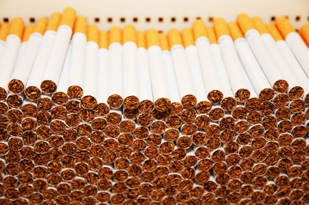 cigarette smoke: Close up of a smoking cigarettes in a stack