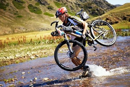 bikercross: ALMATY, KAZAKHSTAN - SEPTEMBER 05:V.Kachanov(N30) in action at Adventure mountain bike cross-country marathon