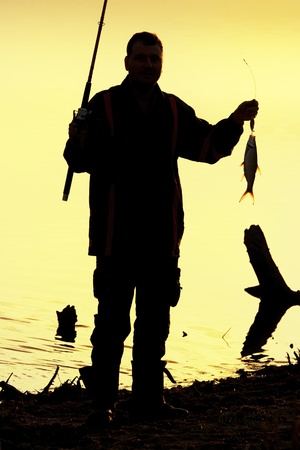 Fisherman silhouette at sunrise Stock Photo - 12539956