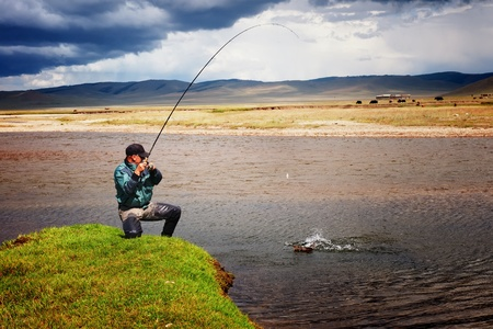 Fishing on river Ider in northern Mongolia Stock Photo - 12819780