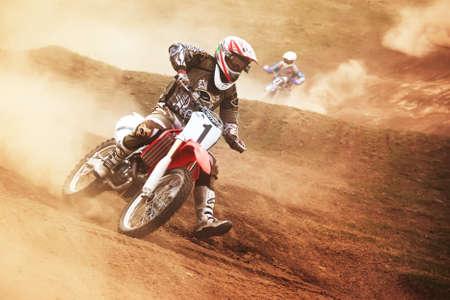 motor race: Almaty, Kazachstan - 10 APRIL: P.Blinov (1) vliegt door de lucht op de Motocross wedstrijd