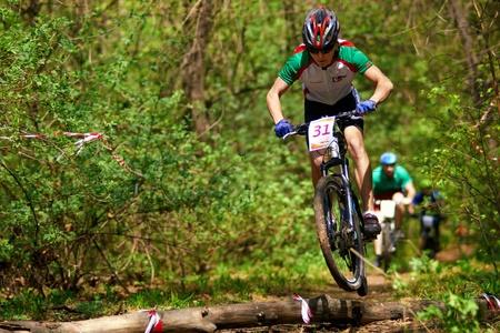 bikecross: ALMATY, KAZAKHSTAN - APRIL 15: S.Plisuchenko (31) in action at cross-country relay race April 15, 2012 in Almaty, Kazakhstan. Editorial