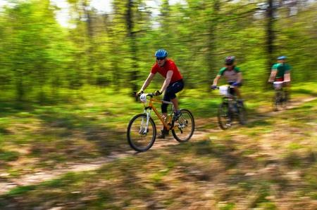bikercross: ALMATY, KAZAKHSTAN - APRIL 15: A.Chernikov (17) in action at cross-country relay race April 15, 2012 in Almaty, Kazakhstan.