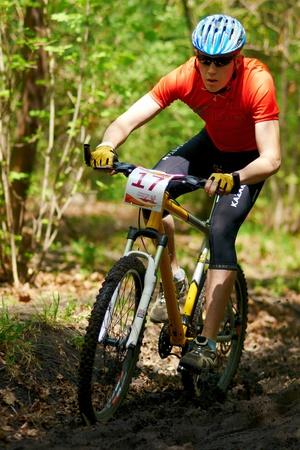 bikercross: ALMATY, KAZAKHSTAN - APRIL 15: V.Gross (17*) in action at cross-country relay race April 15, 2012 in Almaty, Kazakhstan. Editorial