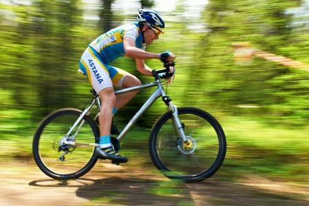 bikercross: ALMATY, KAZAKHSTAN - APRIL 15: A.Nuriev (30) in action at cross-country relay race April 15, 2012 in Almaty, Kazakhstan.