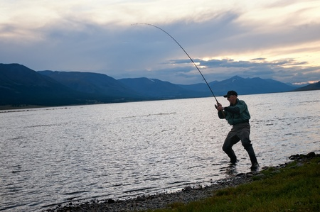 Fly fishing on Lake Hoton Nuur in Mongolia photo