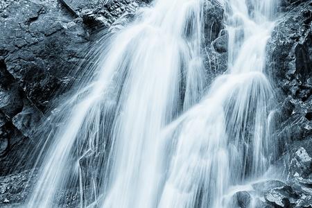 Falling water - blue toned image photo