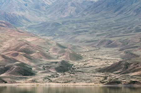 The Bartogay lake in desert mountains,Kazakhstan, the Tien-Shan mountains. Stock Photo