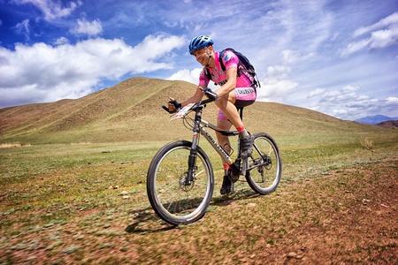 ALMATY, KAZAKHSTAN - APRIL 30: I.Popov (N3) in action at Adventure mountain bike cross-country marathon in mountains