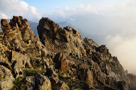 mountain peek: A mountain detail with a rock