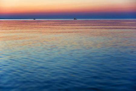 horison: Sunset on sea and the bots on horison