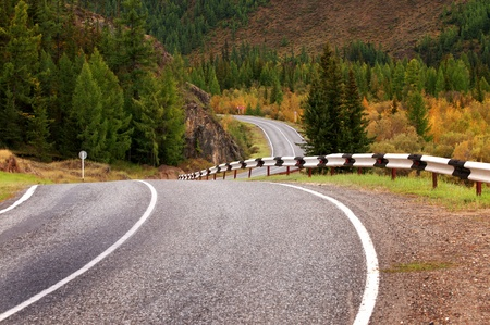 Road in the autumn mountains photo