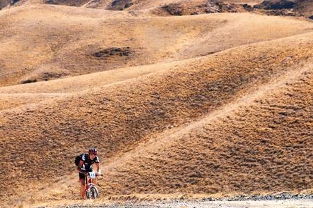 swift: ALMATY, KAZAKHSTAN - SEPTEMBER 09: J.Bakutbekuly (N14) in action at Adventure mountain bike cross-country marathon