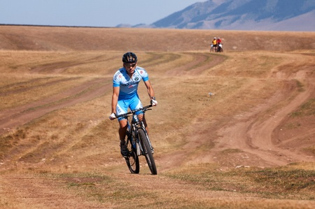 ALMATY, KAZAKHSTAN - SEPTEMBER 09: An unidentified rider in action at Adventure mountain bike cross-country marathon