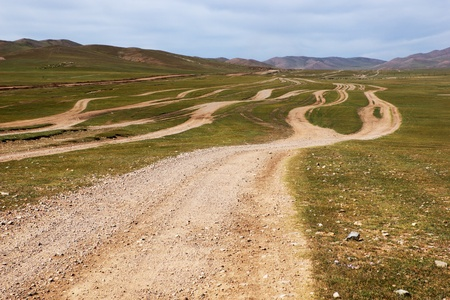 country roads: Roads in the desert steppes of Mongolia Stock Photo