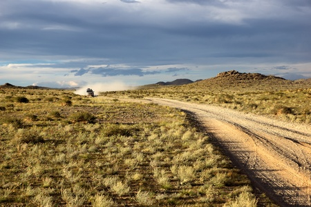 Roads in the desert steppes of Mongolia and car on the horizon Stock Photo - 15363559