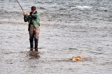 grayling: Fishing on river Shishged in the Mongolia - the lenok fish on hook
