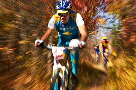 ALMATY, KAZAKHSTAN - OCTOBER 14: A.Anfinogenov (N15) in action at cross-country mountain bike Apple race October 14, 2012 in Almaty, Kazakhstan.