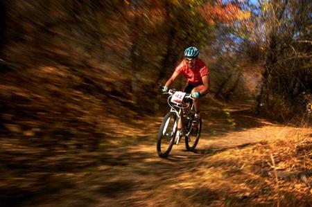 bikercross: ALMATY, KAZAKHSTAN - OCTOBER 14: T.Dauranov (N41) in action at cross-country mountain bike Apple race October 14, 2012 in Almaty, Kazakhstan.