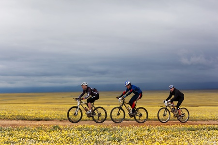 ALMATY, KAZAKHSTAN - MAY 2:V.Skorobogatov (N5),A.Pomortcev (N25) and K.Babin (N3) in action at Adventure mountain bike marathon  Editorial