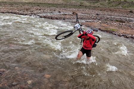 bikercross: ALMATY, KAZAKHSTAN - MAY 3: I.Baranov (N19) in action at Adventure mountain bike cross-country marathon in mountains