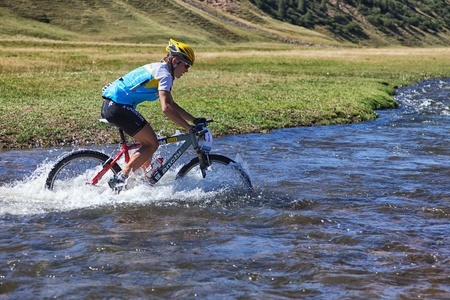 bikercross: ALMATY, KAZAKHSTAN - SEPTEMBER 05: K.Kazantcev(N1) in action at Adventure mountain bike cross-country marathon