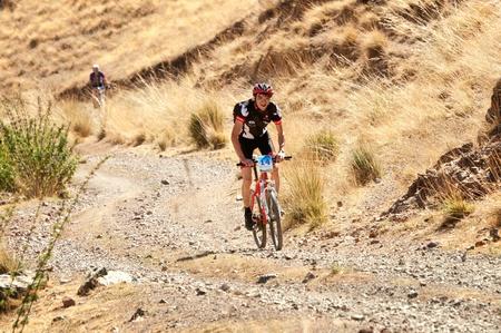 ALMATY, KAZAKHSTAN - SEPTEMBER 09: J.Bakutbekuly (N14) in action at Adventure mountain bike cross-country marathon