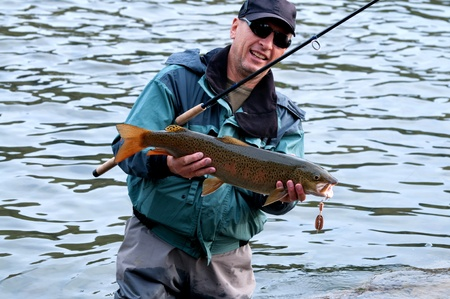 grayling: Fishing on river Shishged in the Mongolia - the lenok fish in hand Stock Photo